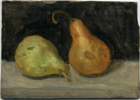 Green and brown pears on grey surface with black backround